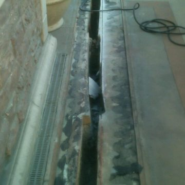 This is what the joint looked like under the old cover plate and gutter.