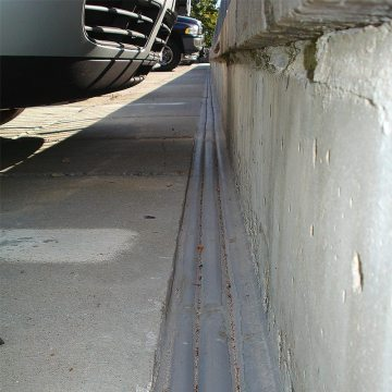 Deck to wall parking garage expansion joint DSM System from EMSEAL