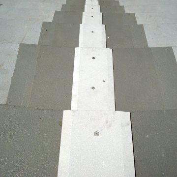 This is a view looking down the completed installation of the SJS SYSTEM in the seating bowl. The sandblasted coverplates are skid resistant and feature a long chamfer on its edges to facilitate pedestrian traffic.