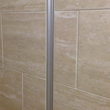 Closeup of Migutrans FS50 wall expansion joint cover installed with flush tile wall covering.