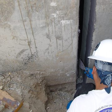 Applying epoxy to joint faces of foundation expansion joint to receive EMSEAL's 20H System.