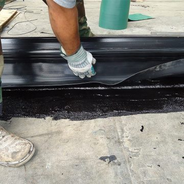 DSM-FP in plaza to wall expansion joint embedding side sheet 2 Houston Center EMSEAL