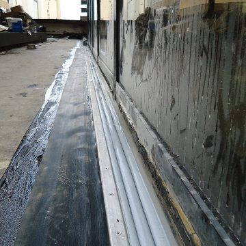Plaza deck expansion joint sealing: DSM-FP in plaza to wall expansion joint with side sheet 2 Houston Center EMSEAL