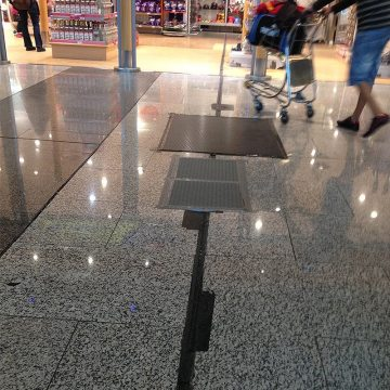 Failed rubber-and-rail floor expansion joints present a trip hazard.