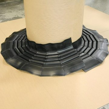 Custom 8-inch (200 mm) RoofJoint factory-welded to follow 3-ft diameter round roof penetration.