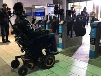 Photo of person in a power wheelchair entering a Translink station