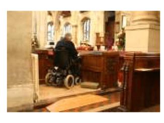 Photo of a church worshipper in a wheelchair
