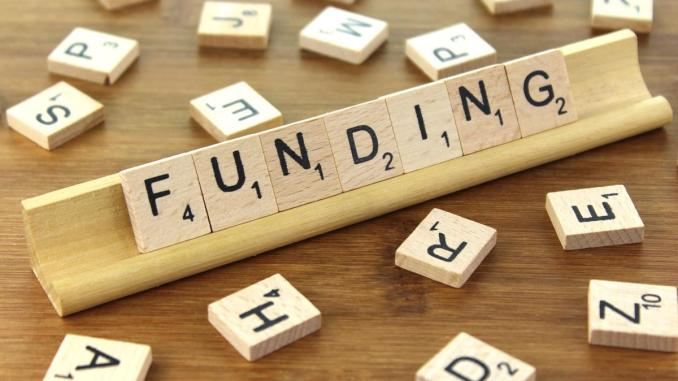 Photo of the words of funding in Scrabble