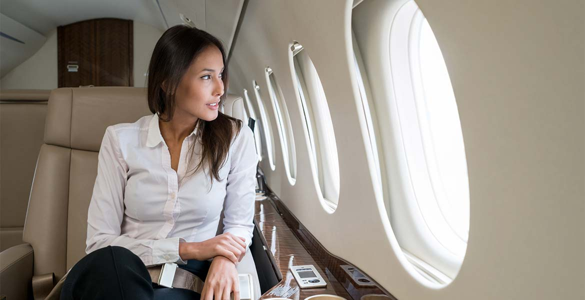 An image of a customer sitting on a private jet chartered by Enborne Estates private estate services air charter