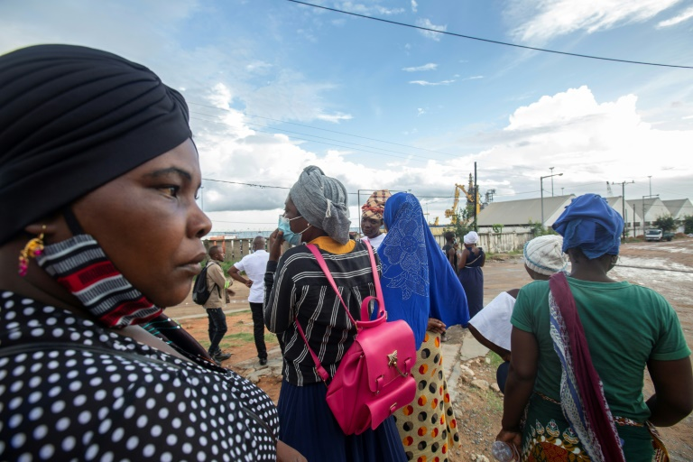 People at the port of Pemba have been waiting for the arrival of loved-ones evacuated from Palma