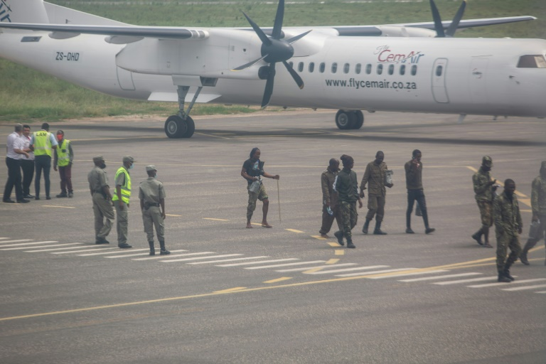 Helicopters carrying humanitarian personnel landed at Pemba airport, alongside a small plane flying troops back from Palma