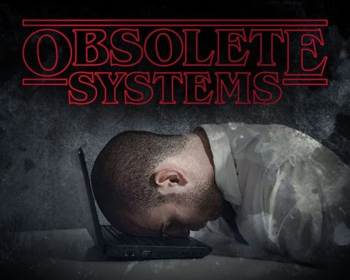 an image of a stressed worker collapsed on his laptop. replacing obsolete systems and conquering the fear of change is essential to the success of your business. encompass solutions erp experts can help.