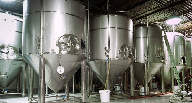 A picture of several vats in a brewery where Non-Alcoholic Beverage Manufacturing takes place.