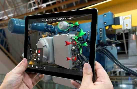 An image of a tablet camera filming a shop floor machine with additional diagrams added via Augmented Reality software.