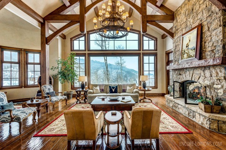 Interior Ranch style living room with Carl Rungius print over fireplace