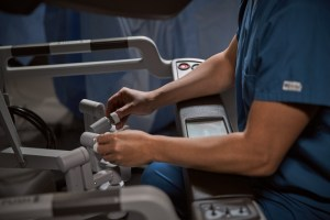 Surgeon's hands on the controls
