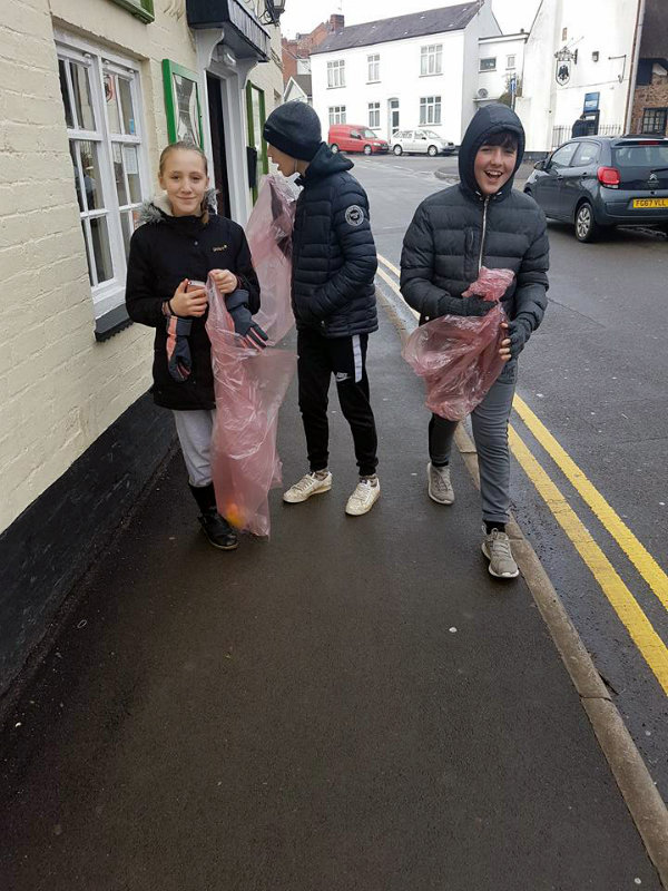 young litter pickers walking through Enderby village