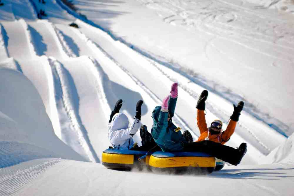 Snow tubing at the Village Vacances Valcartier. A great way to spend winter in Quebec City, starting in December!