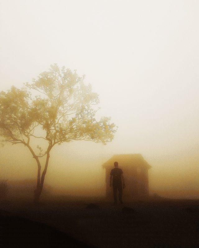 Man stands in thick fog