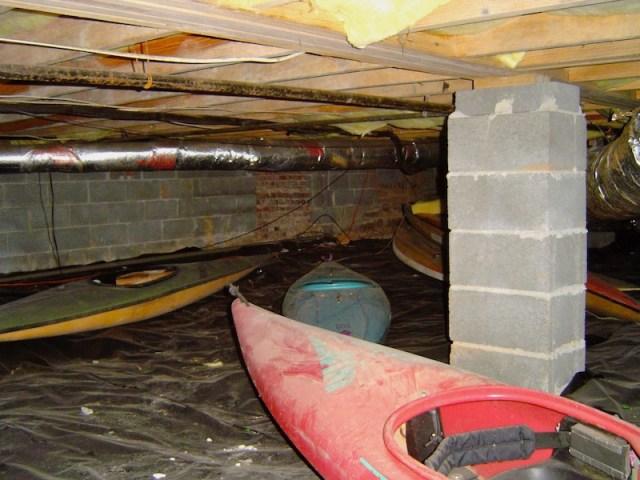 Kayaks in a damp crawl space