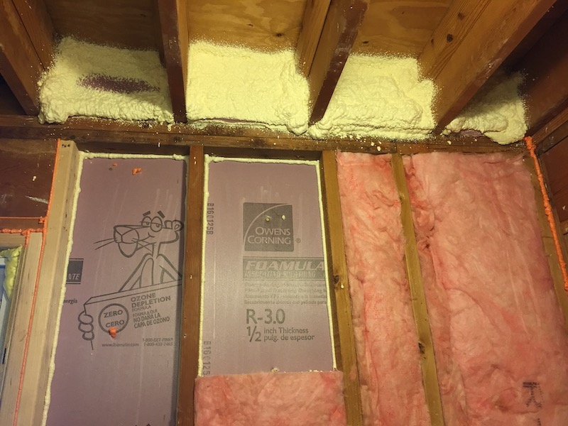 Foam board, spray foam, and fiberglass insulation provide an airtight and well-insulated wall
