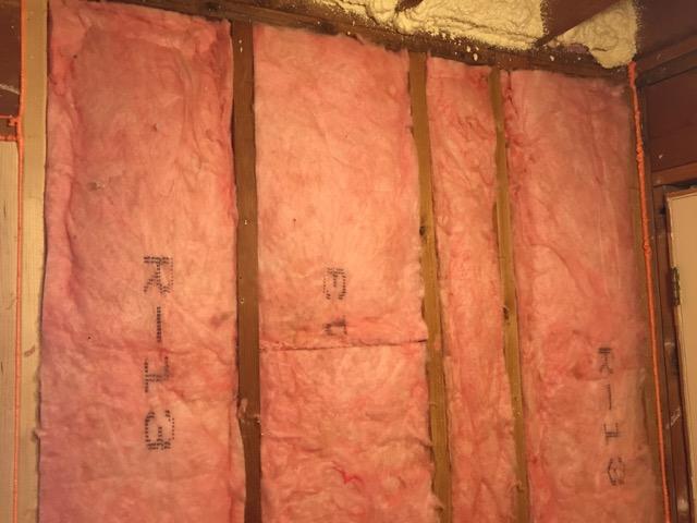 Grade 1 fiberglass batt insulation in an exterior wall