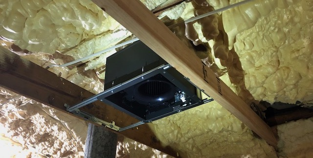 The exhaust fan roughed in before getting more spray foam in the attic