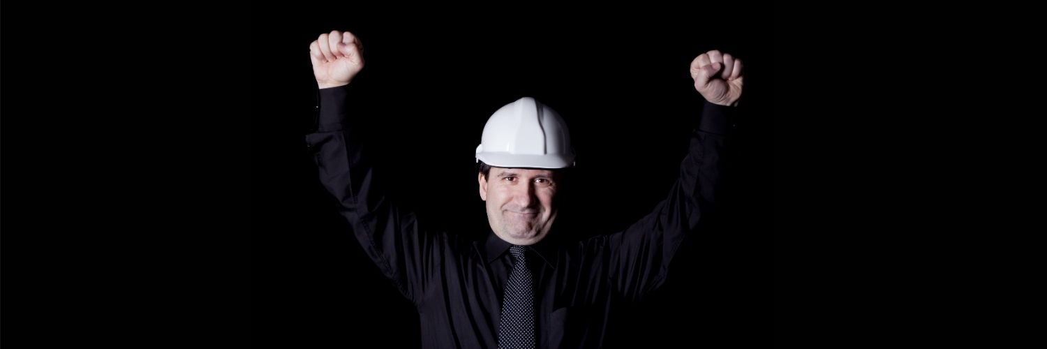 Engineer Raising His Arms In Triumph