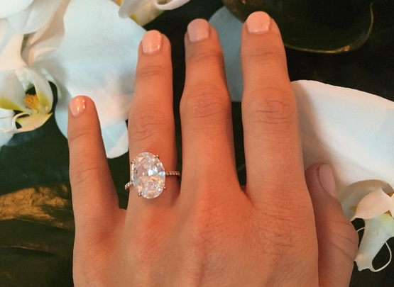 Platinum engagement ring on hand