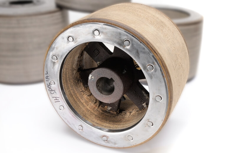 Paper pulleys are made from compressed paper fibers and are formed with metal in the center.