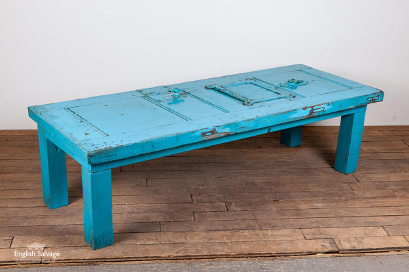 blue table made from an old jail door