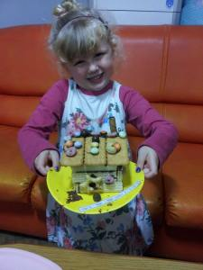 "Very proud of her ""gwaja-jib"" (gingerbread house)."