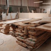 the furniture works stacks of lovely waney edge timber to work with