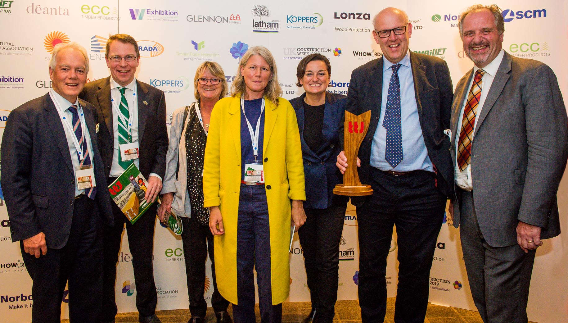 Team EWT English Woodlands Timber & Combilift gang with TTJ Awards 2019 presenter zoe lyons after winning Small timber business of the year