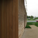 French motorway services Building with Larch cladding & western red cedar detail