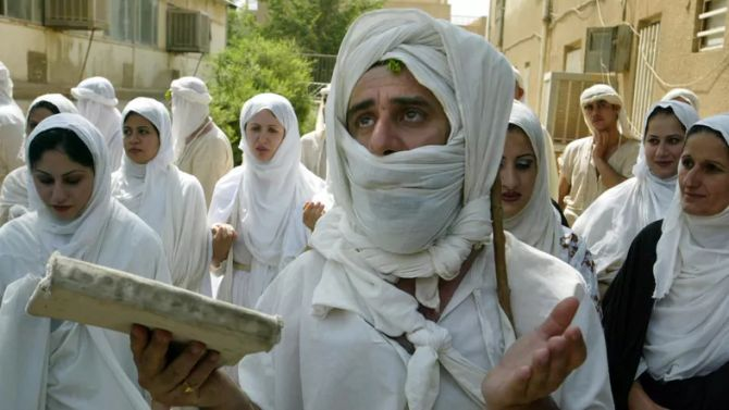 An Iraqi Mandean priest conducts a wedding ceremony for five couples in the ancient Aramaic language..