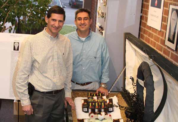 Stephen and David Levet give 100-watt bulb memorial at Atlantic Electrical Supply