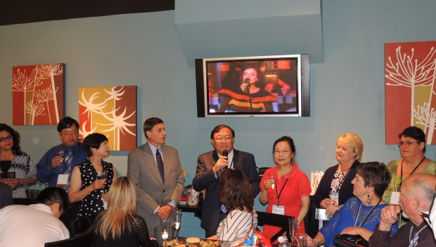During the champagne toast, David and Celia Lu asked some of their long-time employees to surround them as they toasted to 30 years of success.