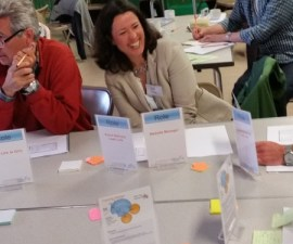 A participant enjoys learning how to play multiple 'Roles' during a 'Tactical' meeting - at a Holacracy training workshop