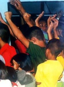 Children worshipping