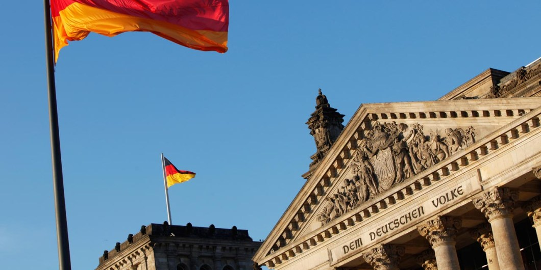 The German flag flys outside the Reichstag, the building which houses the Bundestag (the lower house of parliament), during the presidential election on June 30, 2010 in Berlin. The new German President, whose job is mostly ceremonial but who acts as a kind of national moral arbiter, is not chosen by popular vote but will be elected by a special assembly of MPs and public figures on June 30. AFP PHOTO / DAVID GANNON