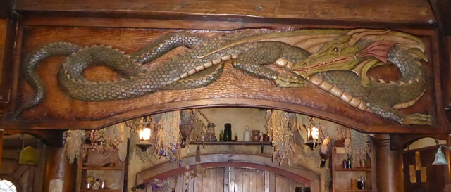 The green dragon carving on the bar lintel at the Green Dragon Inn, Hobbiton.