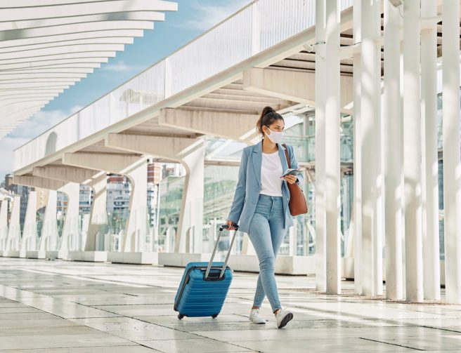 woman-with-luggage-during-pandemic-airport