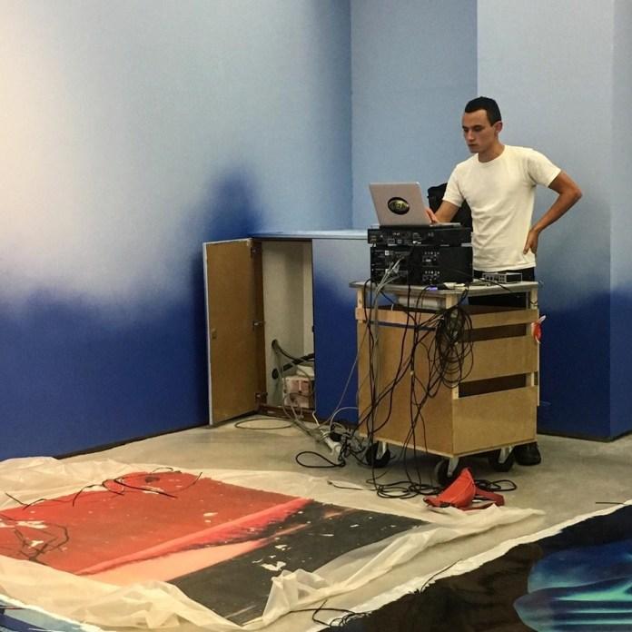 Erwan Sene composing a hydrosatelizzed sound in my upcoming exhibition © Estrid Lutz