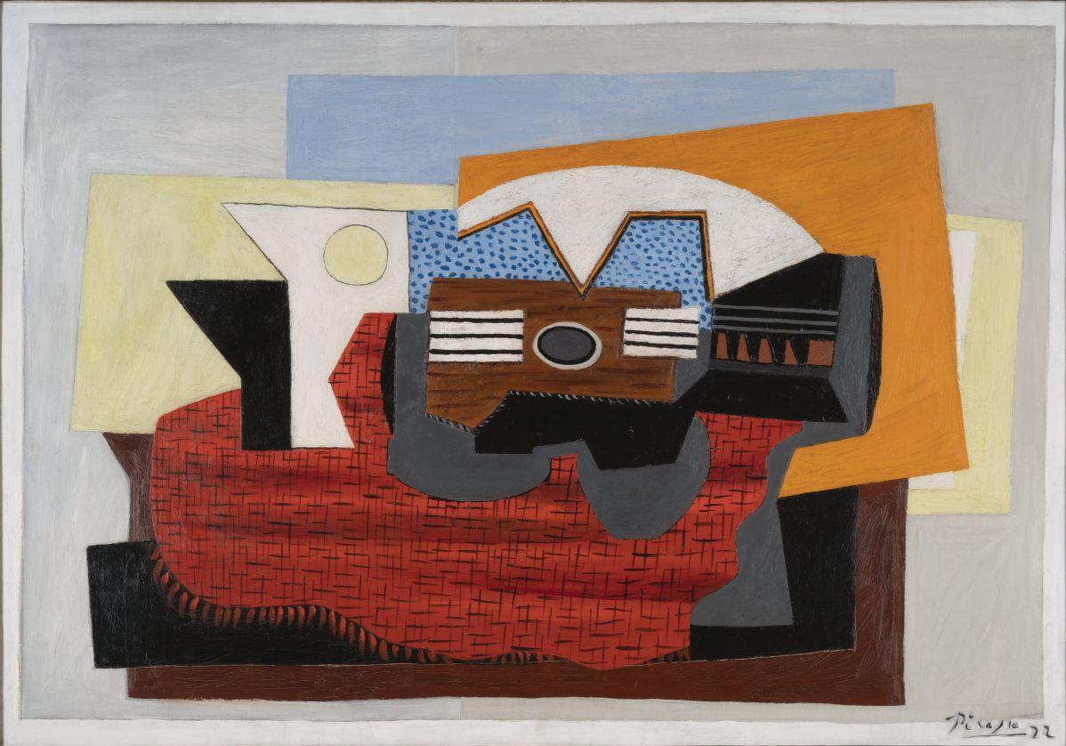 Pablo Picasso - Guitare sur un tapis rouge, 1922