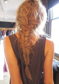 messy fishtail braided hairstyle