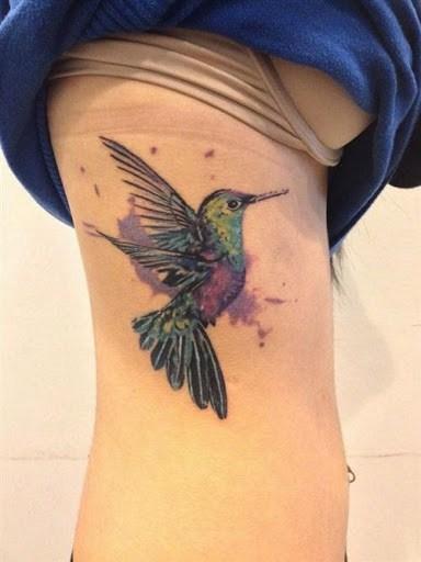 hummingbird tattoo on ribs