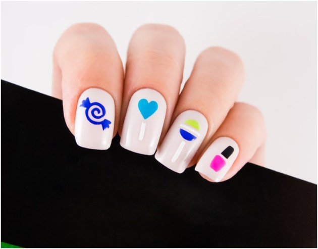 Cute nail designs with blue-black-green and white color on pink nail polish