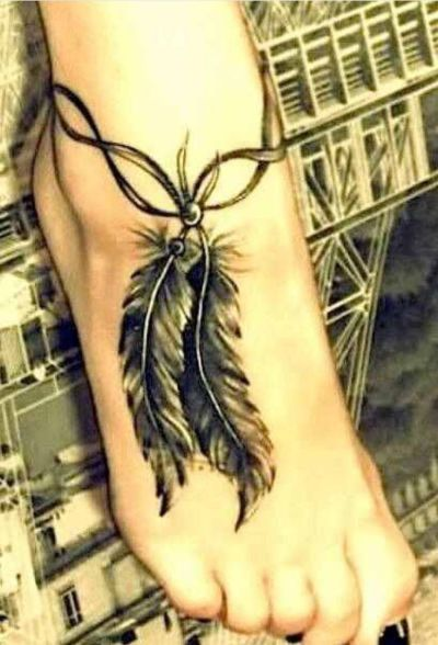 traditional feather on foot tattoo