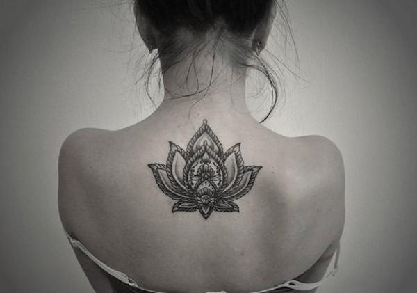 buddhist lotus flower tattoo on back
